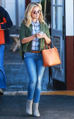 Reese Witherspoon in a plaid shirt, denim, and booties