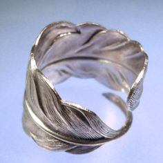 Totally into these wrapped feather ringsi