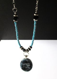 A long necklace, made with silver plated chain, regular metal pendant tray and gemstones: Sky bead, Turquoise and black Onyx. The oval pendant is needle felted with white, blue and black wool. Approximate measurements: Felted Pendant: 2 1/5 x 1 1/4 inch (60 x 33 mm), including the ring. Chain: 24 inch (62 cm) with 3.5 inch (9 cm) extender.  A unique gifts for women!  More necklaces: https://www.etsy.com/ca/shop/AkemiHandmade?ref=hdr_shop_menu§ion_id=14310176  Back to AkemiHandmade…