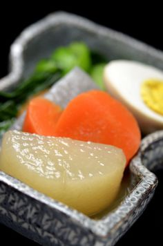 Soy Sauce Simmered Vegetable Dish as Japanese Winter Cuisine (Daikon White Radish, Carrot, Boiled Egg and Green) | Nimono