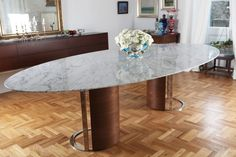 """Kayra Table """"Kayra"""" table was designed for a client in Istanbul, Turkey. We used the highest quality Carrera Marble, cut to an oval, that seats up to 12 people. The table took its inspiration from the house itself. A traditional Turkish yali, the interiors of the space were very beautiful and decorative. We wanted to create a piece that will complement the traditional house, yet bring a modern take to it. We wanted to highlight and lift the thin, 1cm slab of marble and give it lightness…"""