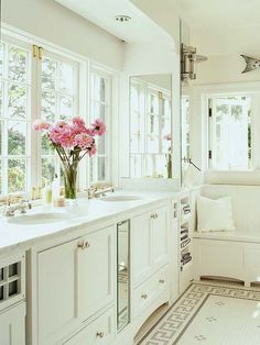 Love the mosaic tile floor and window seat with beaded-board back, in this all-white bathroom...