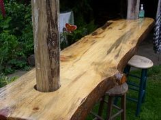 Wood slab bench. This would be a great patio bar!  Bars can be made out of a variety of materials.  Look to the unique!
