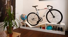 Beautiful and practical bike stand for apartment dwellers.  Also provides clever shoe storage and cycling accessory storage.