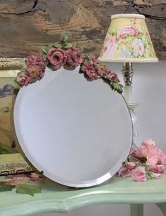this Barbola mirror is framed with exquisite roses.