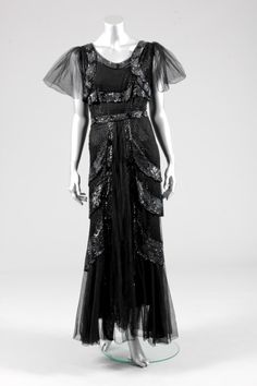 Black sequined tulle evening gown, early 1930s, with smoke-grey sequins, black bugle beaded integral bolero and graduated tiers to the skirt