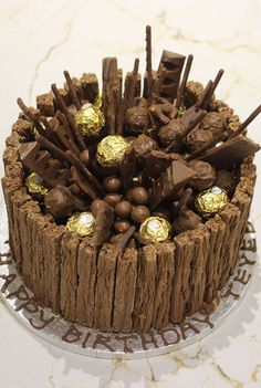 chocolate pops An explosion of chocolate for the serious chocoholics. Chocolate sponge filled with rich chocolate buttercream, popping candy, covered with chocolate flakes. Chocolate Explosion Cake, Chocolate Cake, Chocolate Sponge, Chocolate Buttercream, Chocolate Pops, Cupcakes, Cupcake Cakes, Ferrero Rocher, Fererro Rocher Cake