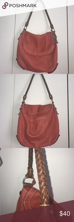 Fossil hobo bag Fossil hobo bag in burnt orange with braided strap and button flap. Pockets on the outside and several on the inside. Fossil Bags Hobos