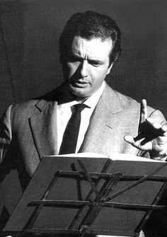Tenor Franco Corelli rehearsing during a recording session.