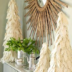 Mini Felt Christmas Trees - Create a Christmas tree trio fit for a winter wonderland with this cozy idea. Cut leaf shapes from ivory felt. Use hot glue to attach the shapes to felt-covered cones, starting at the base and working your way up. Mimic the look of heavy snow-covered boughs by gluing on the felt leaves in an imprecise pattern as shown.
