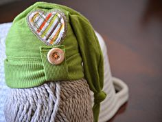 Olive green primitive style newborn elf knot hat. Newborn photography prop. Up-cycled newborn clothing.