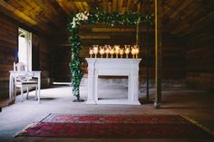 swoon worth barn ceremony, Greenery, candle light and vintage decor.