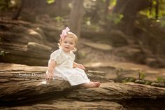 picture-of-18-month-old-girl-sitting-on-a-rock-in-the-creek-taken-by-Fort-Worth-baby-photographer