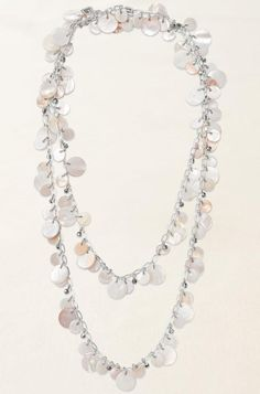 Stella and Dot Toujours necklace...I bought this recently and have received nothing but compliments.  It is a lariet style with a long open hook closure, so it can be worn multiple ways.  I also have the matching earrings.