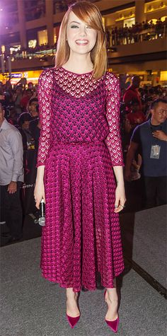 Emma Stone was all smiles at The Amazing Spider-Man 2 fan event in a magenta guipure tulle knit Dior midi dress, keeping her look monochromatic with matching satin d'Orsay Christian Louboutin pumps.