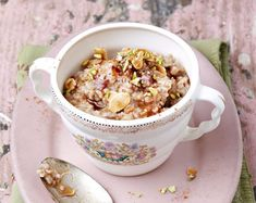Slow Cooker Vanilla Fig Oatmeal with Baklava Topping has a cardamom, vanilla and dried fig base with just a hint of orange flower water. The topping is a gooey mixture of agave nectar, cinnamon and a mixture of nuts.