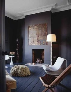 Dark Decor from queen of dark interiors Abigail Ahern whose dark grey living room this is. I love how she has painted the floors and walls both dark and then used light accessories for contrast Dark Living Rooms, My Living Room, Home And Living, Living Spaces, Dark Rooms, Modern Living, Living Area, Painted Floorboards, Dark Wood Floors
