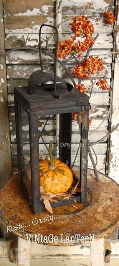 Rusty... Crusty... ViNtaGe Black Lantern adorned with pumpking & leaves...