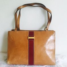 Vintage Kate Spade Leather Handbag Vintage cognac and wine colored handbag. This bag is in vintage condition with marks of wear as shown. I don't mind the marks and faded spots bc it is clearly a unique vintage item and have used it like this with many compliments, but please make sure to check out the pics. Love this bag but I carry bigger ones these days. Authentic! kate spade Bags