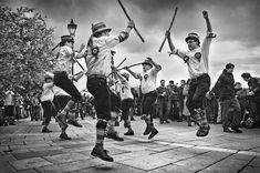 Morris dance is a form of British folk dance usually accompanied by music. It is based on rhythmic stepping and the execution of choreographed figures by a group of dancers. Implements such as sticks, swords, handkerchiefs and bells may also be wielded by the dancers.