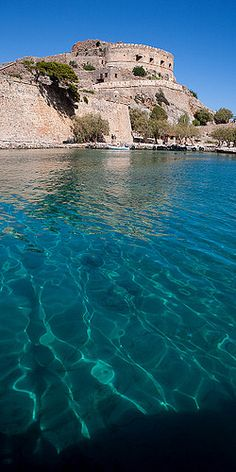 The island of Spinalonga ~ officially known as Kalydon, is located in the Gulf of Elounda in north-eastern Crete, Greece.
