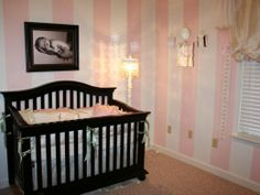 pink striped nursery wallpaper--love the idea, just not the pink. though it definitely has a romantic feel to it