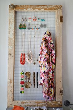Add chicken wire to an upcycled kitchen cabinet window for a way to easily access earrings, necklaces, and other accessories. Get the tutorial at The Apron Blog.   - CountryLiving.com
