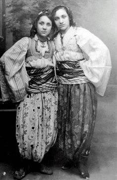 MOTHER TERESA  on left, as a teen in native Albanian clothing.