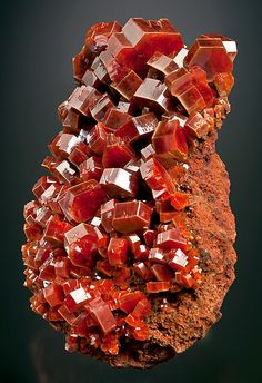 Vanadinite on matrix, From the ACF Mine, Mibladene, Midelt, Khénifra Province, Meknès-Tafilalet Region, Morocco.  Measures 12.2 cm by 7.5 cm by 4.5 cm in total size.  Ex. K. Cooper Mineral Collection
