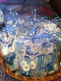 Winter Goody Bags-Contains hot chocolate package, peppermint lifesavers and Hershey kisses. In cellophane bag with snowflake tag and ribbon.