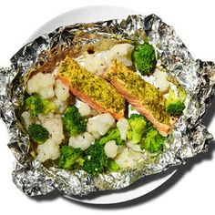 Baked Salmon with Mustard and Herbs  Preheat the oven to 350 degrees. Coat a 6-ounce salmon fillet with 1 teaspoon mustard; sprinkle with 1 tablespoon chopped dill, 1 tablespoon chopped parsley, and 1 tablespoon chopped chives and place in a baking dish. Mix 1 cup broccoli florets; 1 cup chopped cauliflower; 1 tablespoon olive oil; and 3 garlic cloves, minced. Add to baking dish alongside salmon, cover with foil, and bake until fish is cooked through, about 20 minutes.