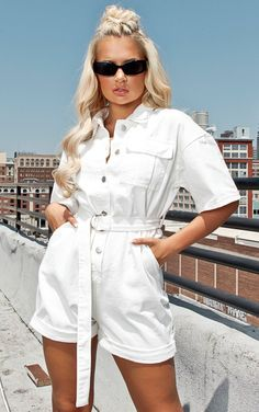 White Denim Summer Romper Shorts With Button Front And Short Sleeve. This white denim romper is the perfect summer pick featuring a white denim material in a shorts style with an attached belt that cinches in your waist, what's not to love? White Denim Jumpsuit, Denim Playsuit, Jean Romper, Playsuit Romper, All White Romper, White Playsuit, Diy Shorts, Modest Shorts, Combi Jean