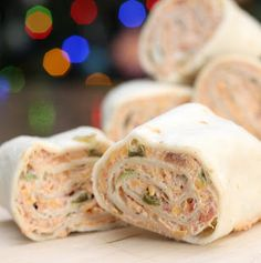 Spicy Tortilla Roll-ups  12 oz cream cheese, softened 1 C sour cream 1 (1 ounce) package dry fiesta-style ranch dressing mix 1 1/2 C chunky salsa 2 C shredded Cheddar cheese 1/4 C chopped green onion 1/4 C diced pickled jalapeño 1 Tbsp chili powder 1 tsp cumin 10 (10 inch) flour tortillas Add shredded chicken for a more tasty option.