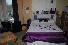 "BEDROOM (1): 15' 4"" x 15' 3"" (4.67m x 4.65m) Large double bedroom with bay window, original fireplace & carpet flooring. | 284 Woodstock Road, Belfast | Propertynews.com"