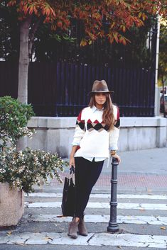 Fall outfit. Women style. Brown hat, white sweater, black trousers handbag. Simple and beautiful clothing