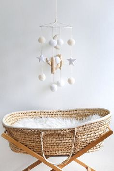 Gender neutral nursery mobile and rustic jute cot.  gender | gender neutral nursery | nursery inspo | nursery decor inspo | gender neutral decor | new born baby | fashion | trends | cute | nursery furniture | pregnancy | maternity | sleep | cot | cosy | comfortable