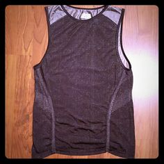 """Athleta metallic finish tank This tank is SO cool, but I need to pare down. Material is a silky black with silver accents. Smoke-free home. There appear to be some pulls across the top back, but it doesn't look bad. Priced accordingly.  Length: 24"""" Width: 17"""" (armpit to armpit) Athleta Tops Tank Tops"""