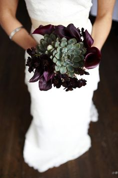 dark colours in a bouquet offer great contrast for a white wedding dress. don't think that 'dark' translates to 'gothic' and experiment!