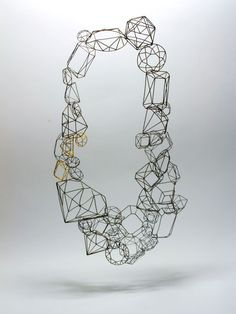 karin maisch - prunkstück - 2009. gold. steel. collier. how much pomb can you leave out without loosing the pomb?