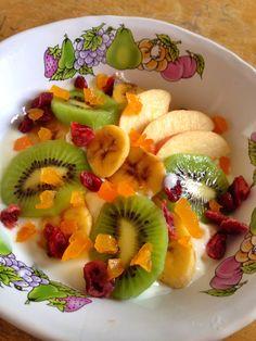 Muesil with  banana,kiwi,red apple,dried fruit and yogurt