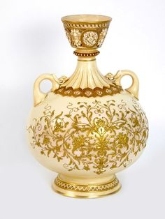 A Royal Worcester blush ground Vase, the twin-handled vase with floral gilt decoration, shape number 1109, printed number, painted initials HY, 29cm high