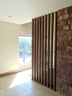 Behind Spiral Stairs By fireplace. Can mimic this for swivel tv stand? Living Room Divider, Living Room Partition Design, Room Divider Walls, Room Partition Designs, Interior Design Living Room, Living Room Designs, Interior Decorating, Wood Partition, Design Case