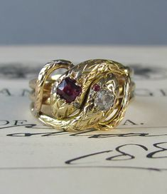 STUNNING 18k solid gold antique Victorian double snake ring. Offered by LeolaRevives