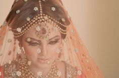 OMG. Gorgeous. The veil w/ the jewelry and crazy-sexy cat eye is...amazing.