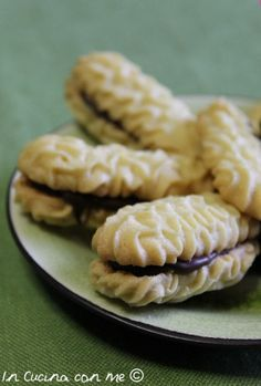 http://www.incucinaconme.com/biscotti/biscotti-allolio-al-profumo-di-limone/
