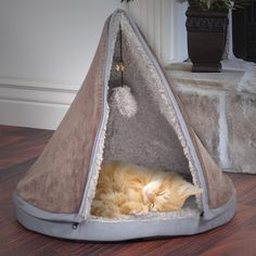 Features:  -Cover material: 100% Polyester.  -Filling material: 100% Polyurethane foam.  -Teepee style cat bed.  -Removable teepee top.  -Features dangling sherpa ball and bell.  -Thick memory foam be