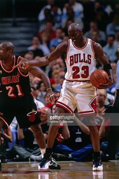Michael Jordan #23 of the Chicago Bulls gestures in Game Two of the Eastern Conference Finals during the 1997 NBA Playoffs at the United Center on May 22, 1997 in Chicago, Illinois. The Bulls defeated the Heat 75-68.