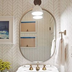 We kept it simple for our client's Powder Room refresh... chic art, new lighting and one of our favorite @serenaandlily Feather Wallpaper did the trick.  #CecyJInteriors  #PowderRoom #California #Barefoot #Design photographed by @dagen