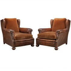 Pair of Leather/Velvet Lounge Chairs | From a unique collection of antique and modern lounge chairs at https://www.1stdibs.com/furniture/seating/lounge-chairs/
