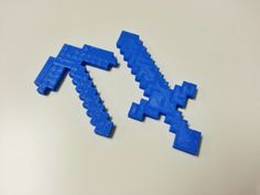For all the Minecraft players out there, we 3D printed a diamond sword and axe! Follow us for more 3D printed objects. #Minecraft #crafting #blocks  - Minecraft Diamond Sword by Moyzro - www.thingiverse.com/thing:222497 - Minecraft Pickaxe by ArcTiC_Trickyyy - www.thingiverse.com/thing:23280